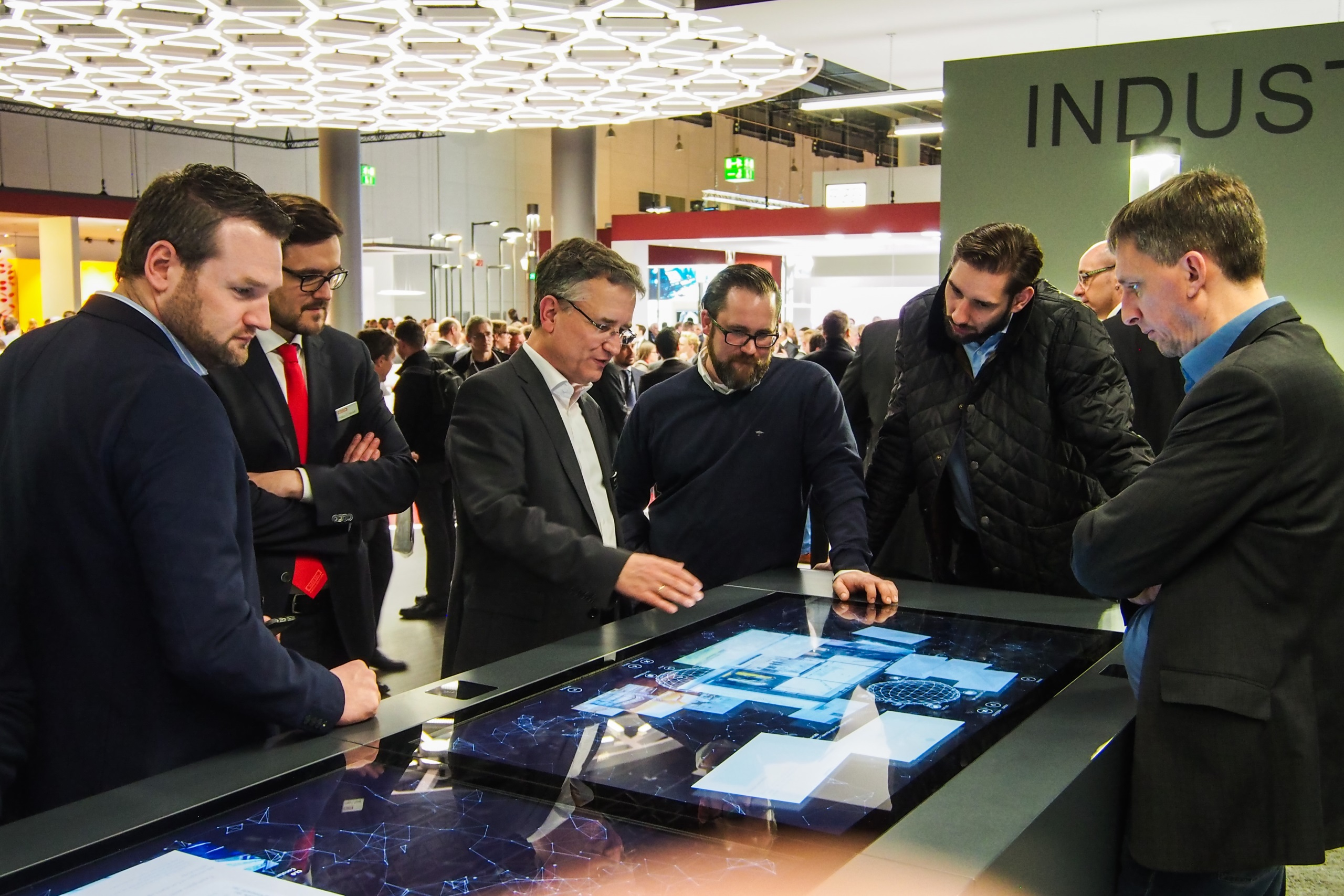 trilux unity trade fair application booth with multitouch table